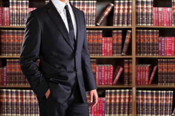Midsection Of Lawyer With Hand In Pocket