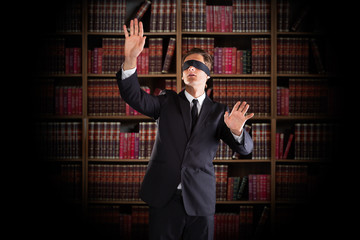 Blindfolded Lawyer Gesturing In Office