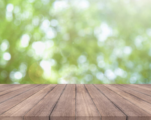 Wooden table and bright spring bokeh background - can be used for display your products