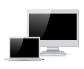 White monitor and notebook with black screen