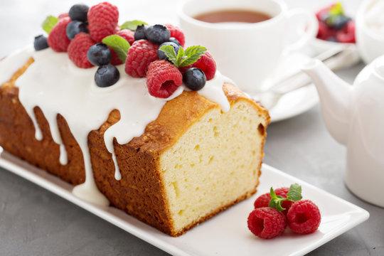 Yogurt pound cake with glaze and fresh berries