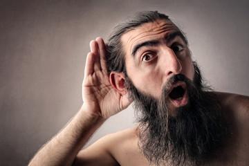 Long-bearded man listening