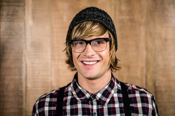 Happy blond hipster smiling