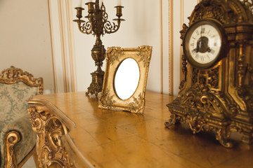 Antique golden frame on table at luxurious interior