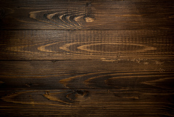 Closeup texture of dark wooden planks. Horizontal background wit