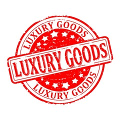 Damaged round red stamp with the word - luxury goods - vector eps