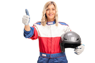 Female car racer giving a thumb up