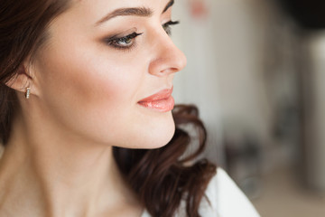 Beautiful young lady with soft make up