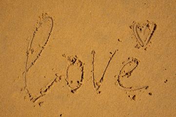 love word written on brown sand