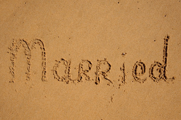 sign Married written in sand.