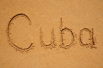 sign cuba writen on sand
