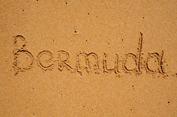 sign Bermuda writen on sand