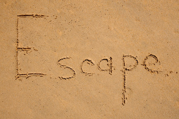 Escape message on the beach sand