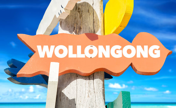 Wollongong welcome sign with beach