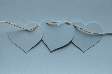 Blue paper hearts on blue background
