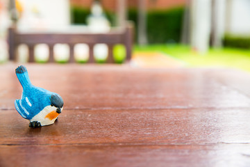 Bird statue on a wooden floor