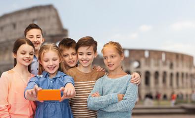 children talking smartphone selfie over coliseum
