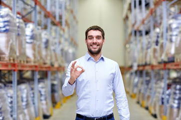 happy man at warehouse showing ok gesture