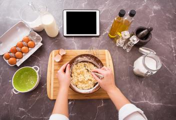 Woman using ipad for recipe