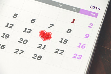 Close up calendar with mark at days 14