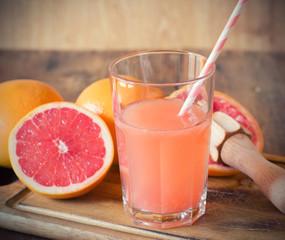 Glass of fresh organic grapefruit juice ready to drink