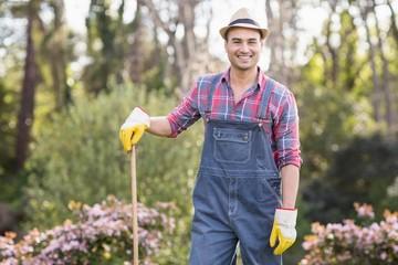 Gardener man posing with his rake