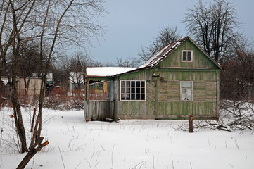 Abandoned wooden house in the winter
