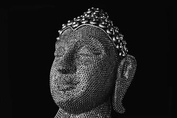 Portrait of a Buddha statue. Black background