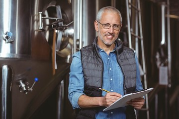 Happy brewer checking his list