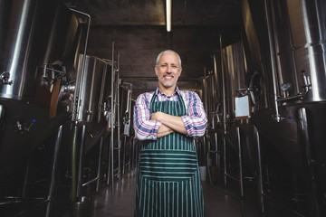 Happy brewer smiling at camera