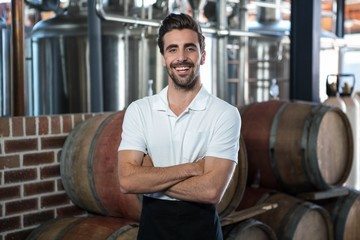 Handsome brewer crossing his arms