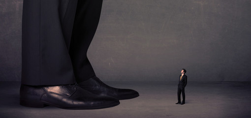 Huge legs with small businessman standing in front concept
