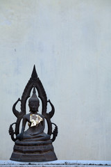 buddha image with grunge wall.
