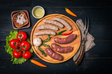 Raw sausage with spices and  vegetables