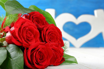 Red roses and heart on Valentines Day with space for text