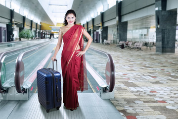 Indian woman in the airport hall