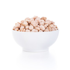 Raw dry chickpeas in bowl on white background