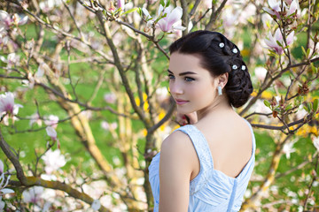 Young tender girl with magnolia