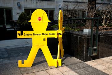 Sign, caution ground under repair