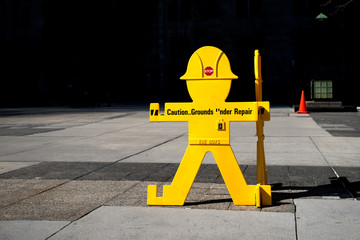 Sign, caution ground under repair