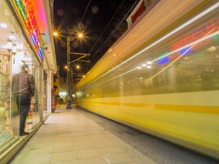 Passenger street tram departing