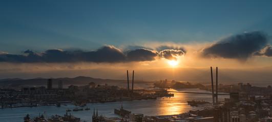 Vladivostok cityscape, dramatic sunset sky.