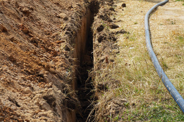 Deep narrow ditch for water pipe