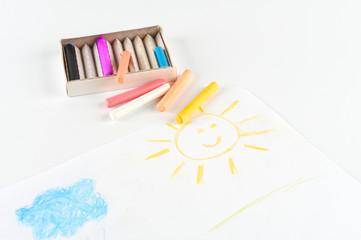 Children drawing pastel crayons.