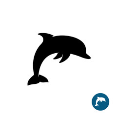 Dolphin simple black silhouette logo. Sea freedom symbol.