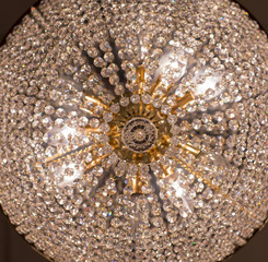 Acrylic Prints Brass chandelier with crystal. Lighted chandelier with crystal pendants.