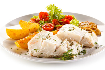 Fish dish -  boiled fish fillet, baked potatoes and vegetables