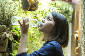 Woman shorthair drink natural water in the garden