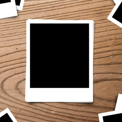 blank photo frame on brown wood old background texture