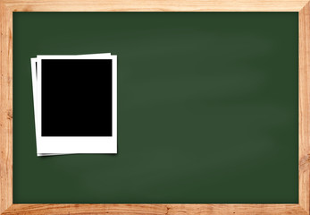 Photo frame on black wood blackboard background for school conce